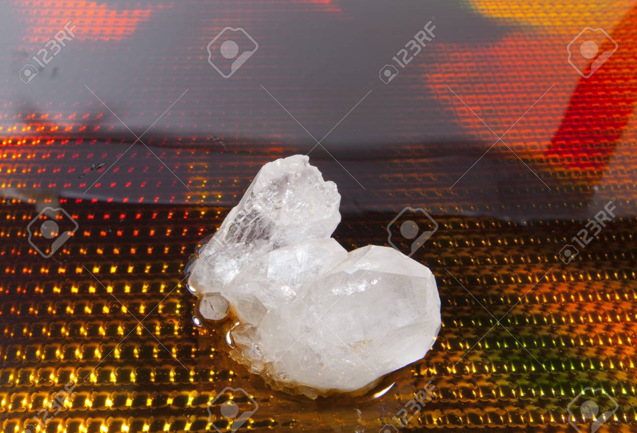 A quartz crystal against a colorful background. Stock Photo - 20692181