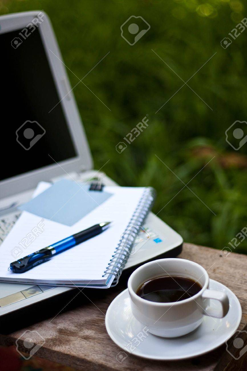 paper note on notbook with coffee in garden. Stock Photo - 7283472