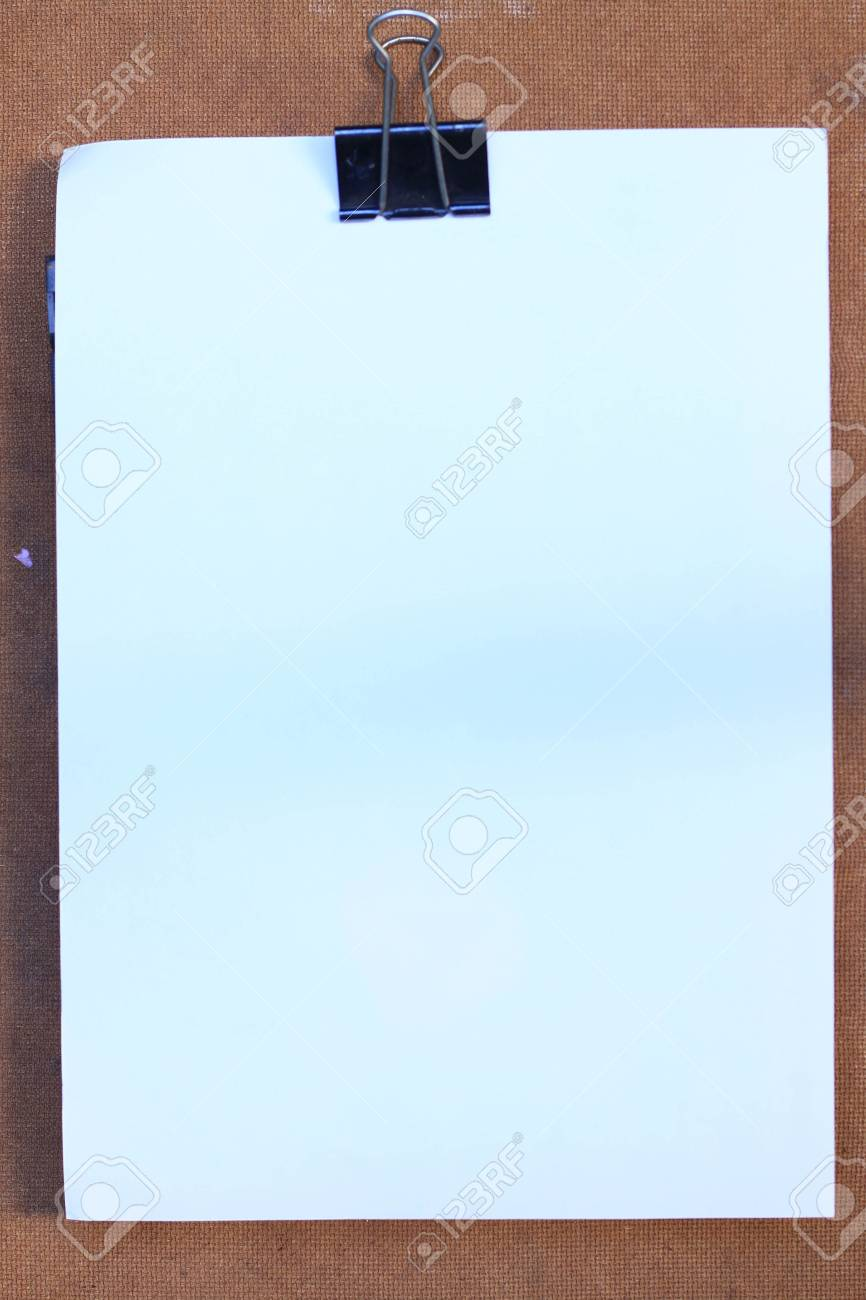 white and clip on wood background Stock Photo - 8263107