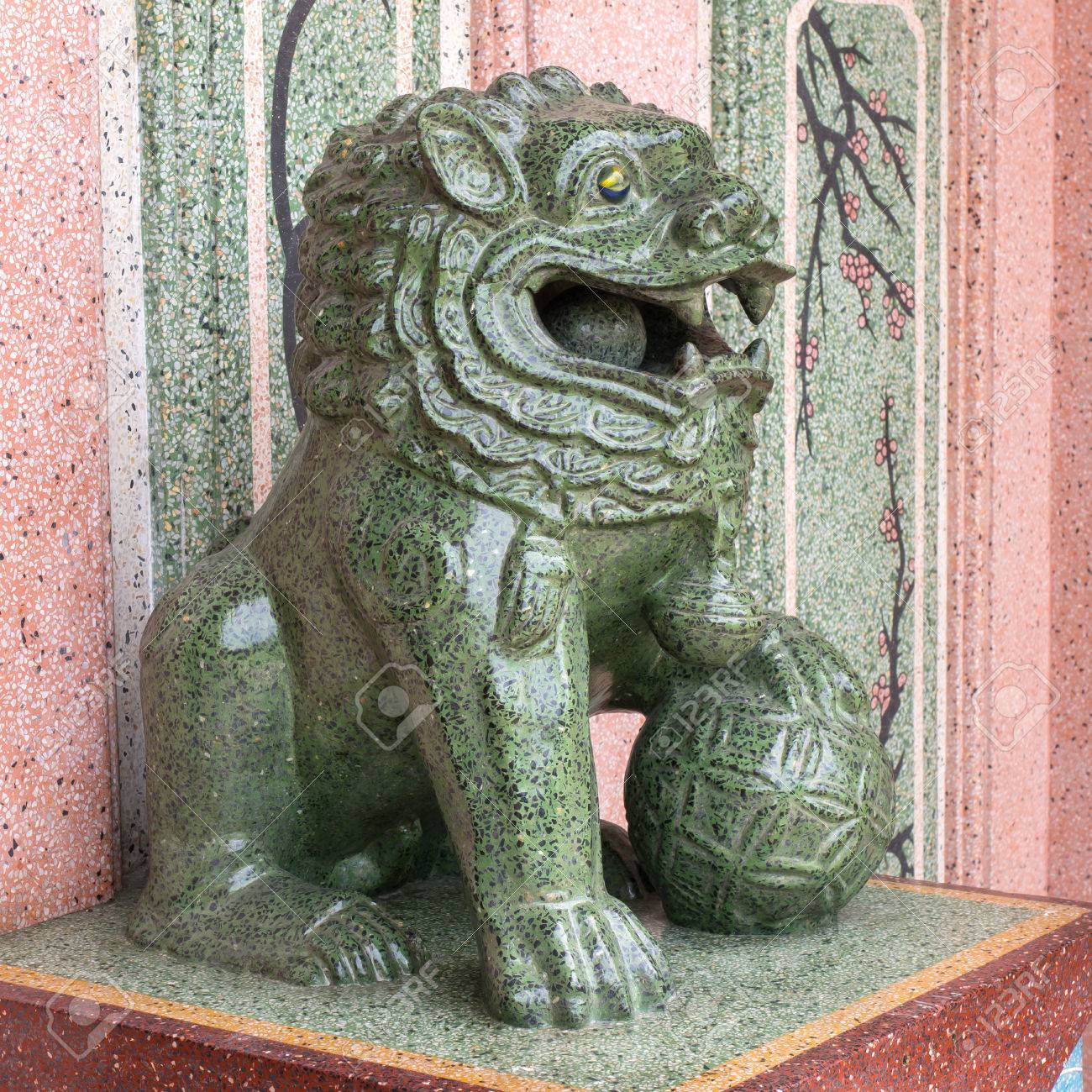 Chinese Lion In Green Jade Color Statue Is Symbol In Chinese Stock