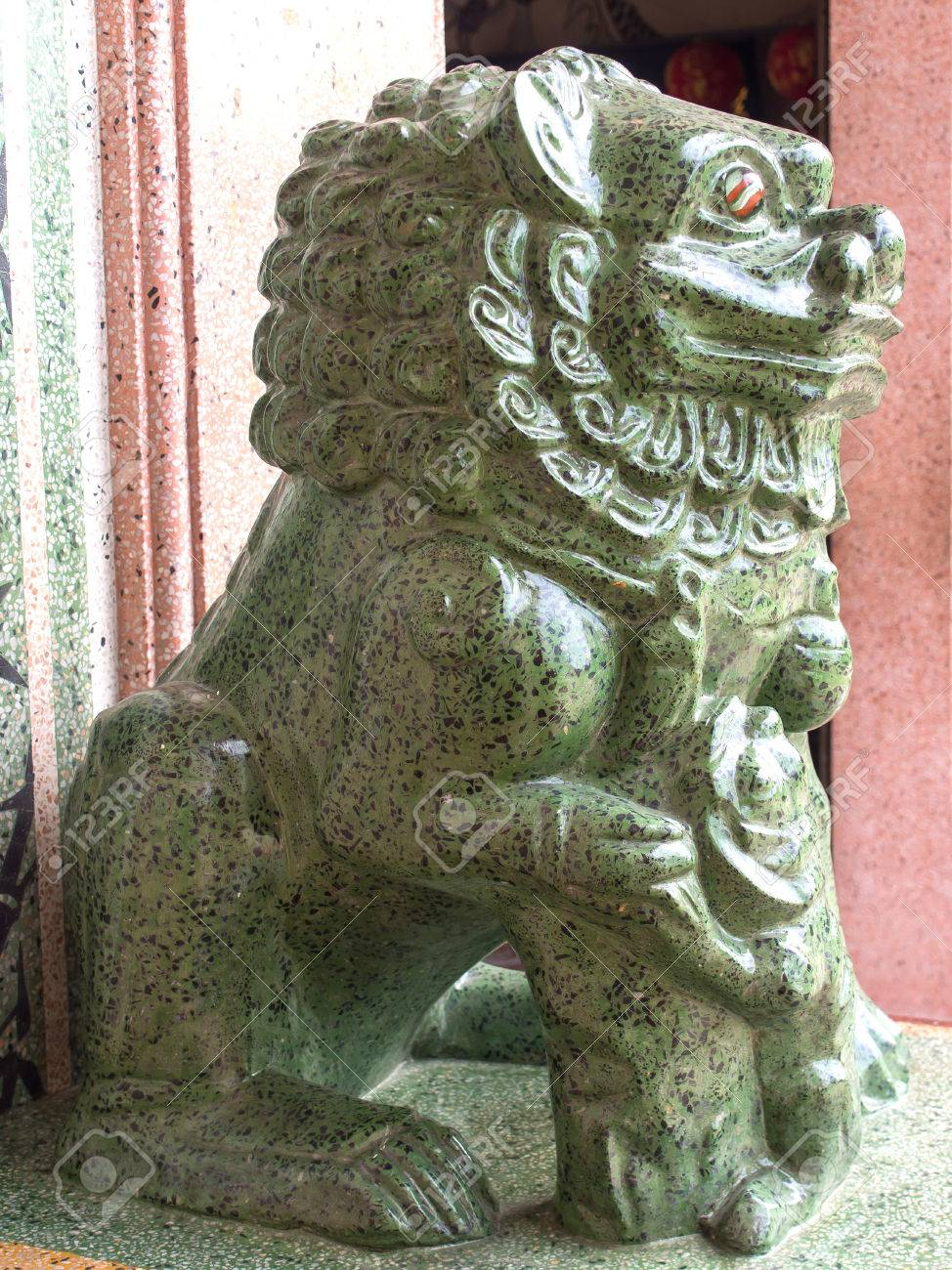 Chinese Lion Statue In Green Jade Colour Is Symbol In Chinese