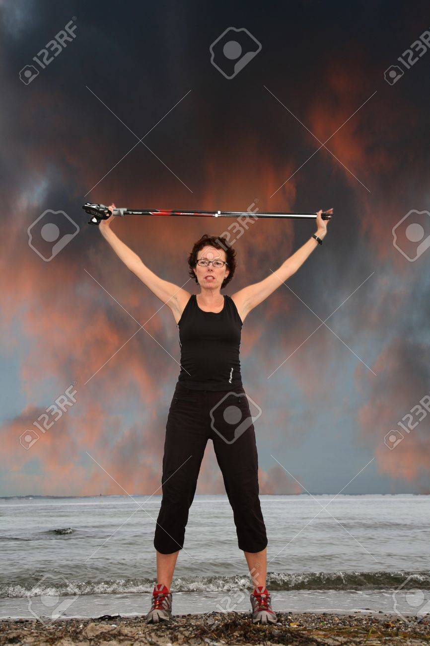 woman training nordic walking on a beach in denmark Stock Photo - 10071018