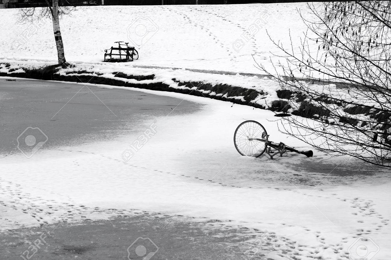 bike on an iced lake in  in a village in denmark Stock Photo - 11752221
