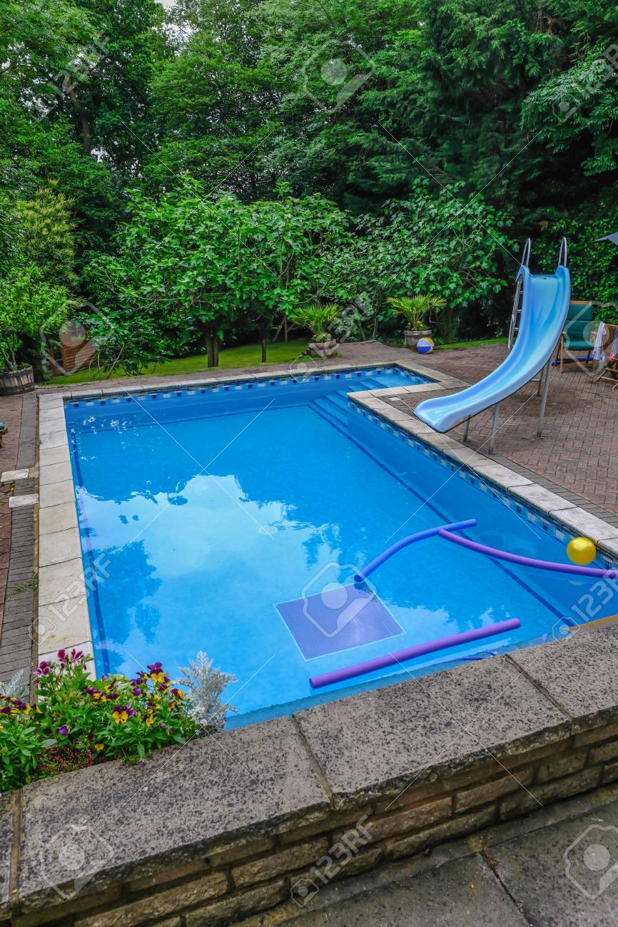 north london, england, uk - june 3, 2018: garden swimming pool..