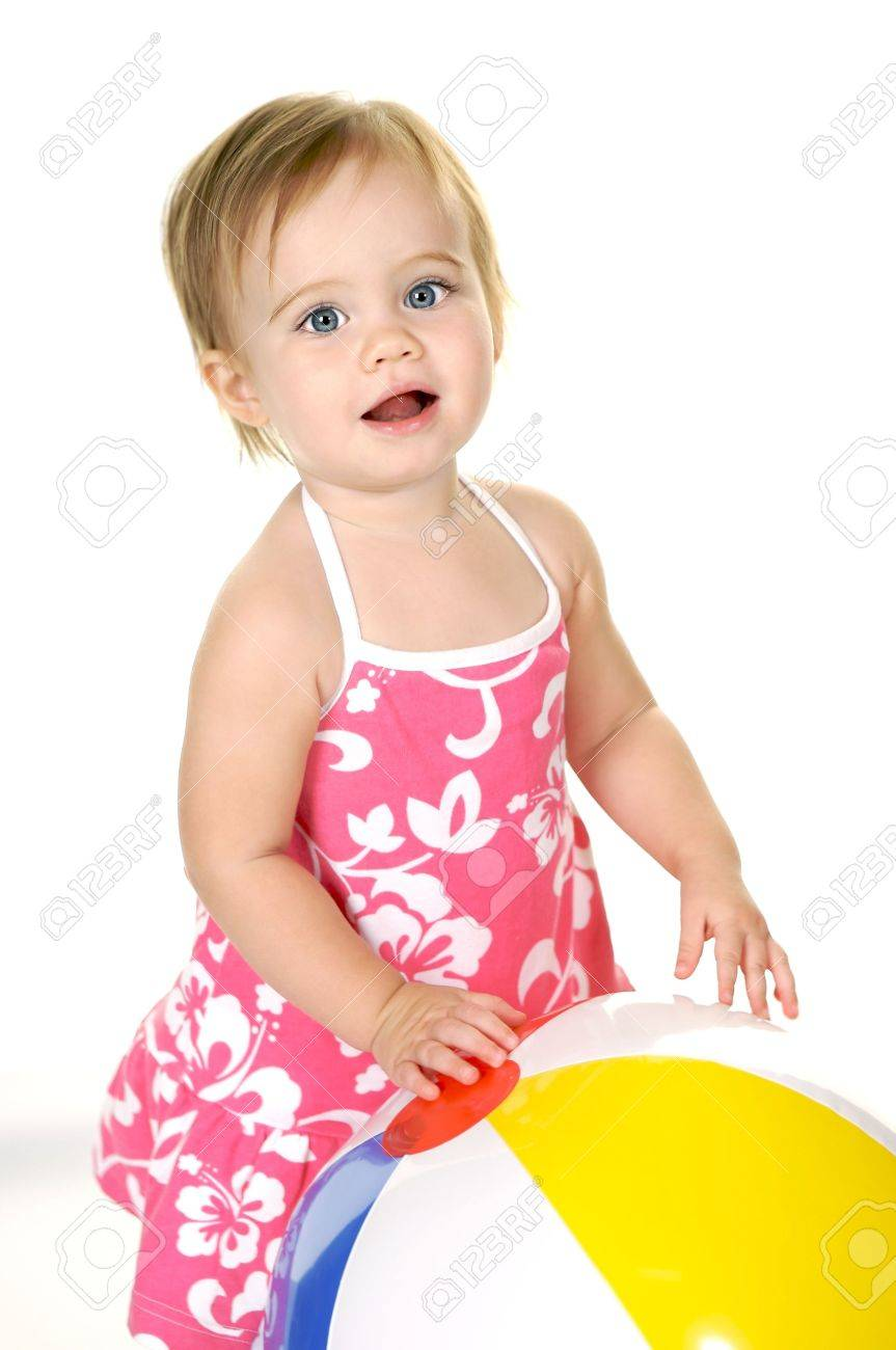 5e85351cbcd1 Sweet Little Girl With Big Blue Eyes In A Pink Dress With A Beach ...