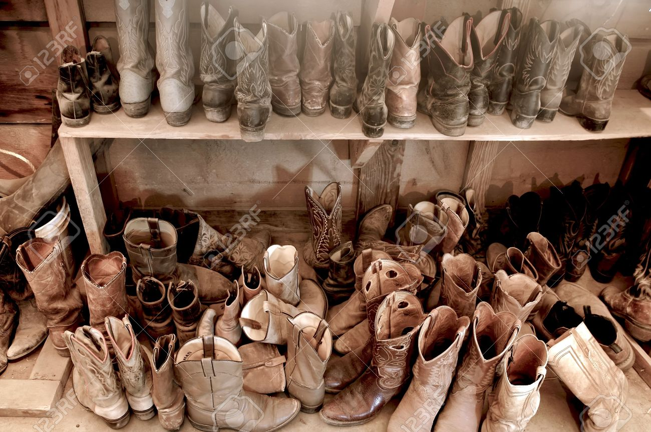 Tack Room Full Of Well Worn Cowboy Boots Stock Photo, Picture And ...