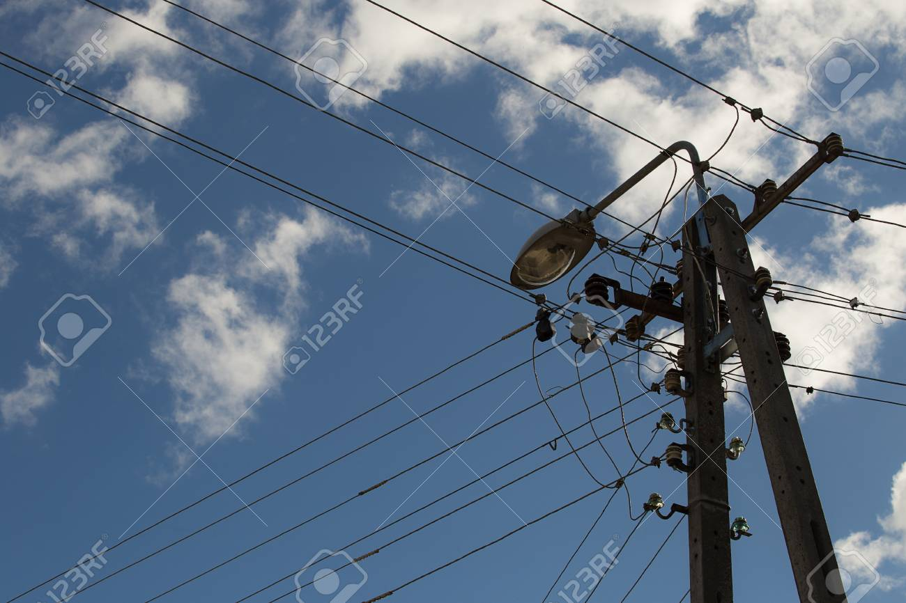 Surprising Electric Wires Hanging On A Pole With A Lighting Lamp Photographed Wiring 101 Hateforg