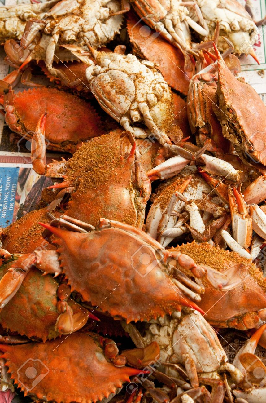 A Pile Of Steamed And Seasoned Blue Crabs. Stock Photo, Picture