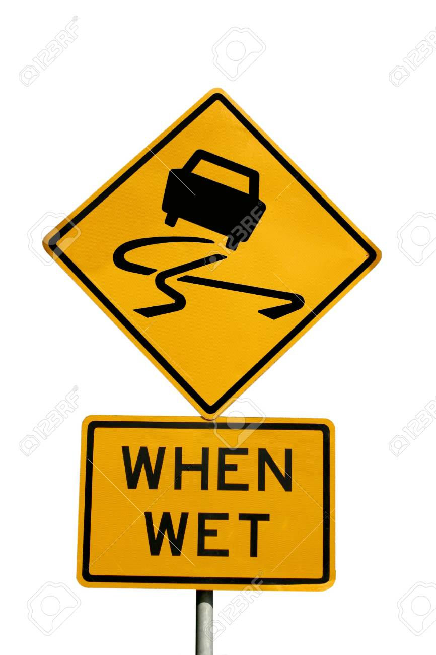 A warning slippery when wet sign isolated on white Stock Photo - 3438334