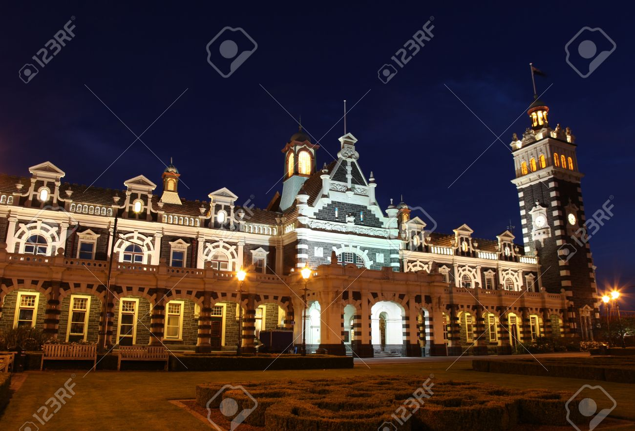 Dunedin's famous historic railway station at nightime. - Dunedin New Zealand. This ornate Flemish Renaissance-style building was opened in 1906 and is a famous landmark in the University city. Stock Photo - 10006309