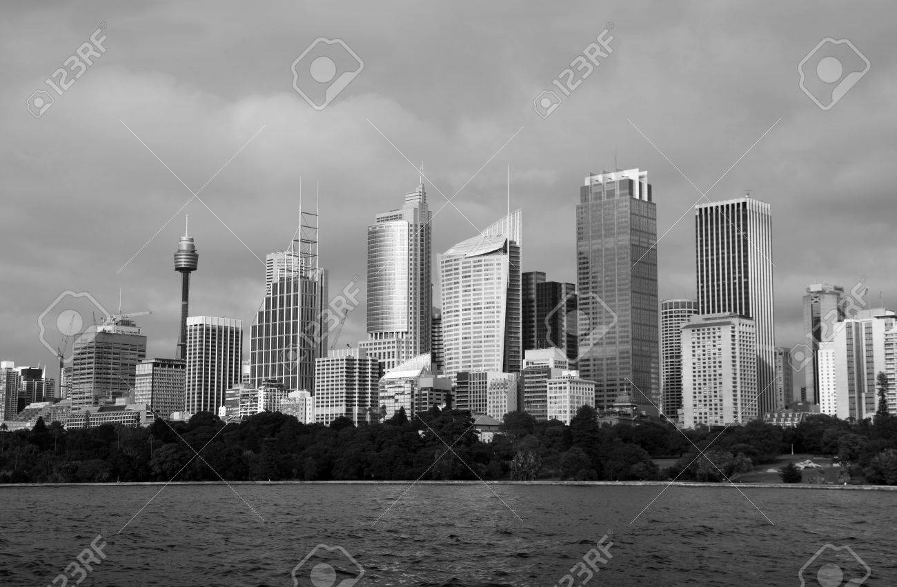 A black and white image of sydney skyline across farm cove on