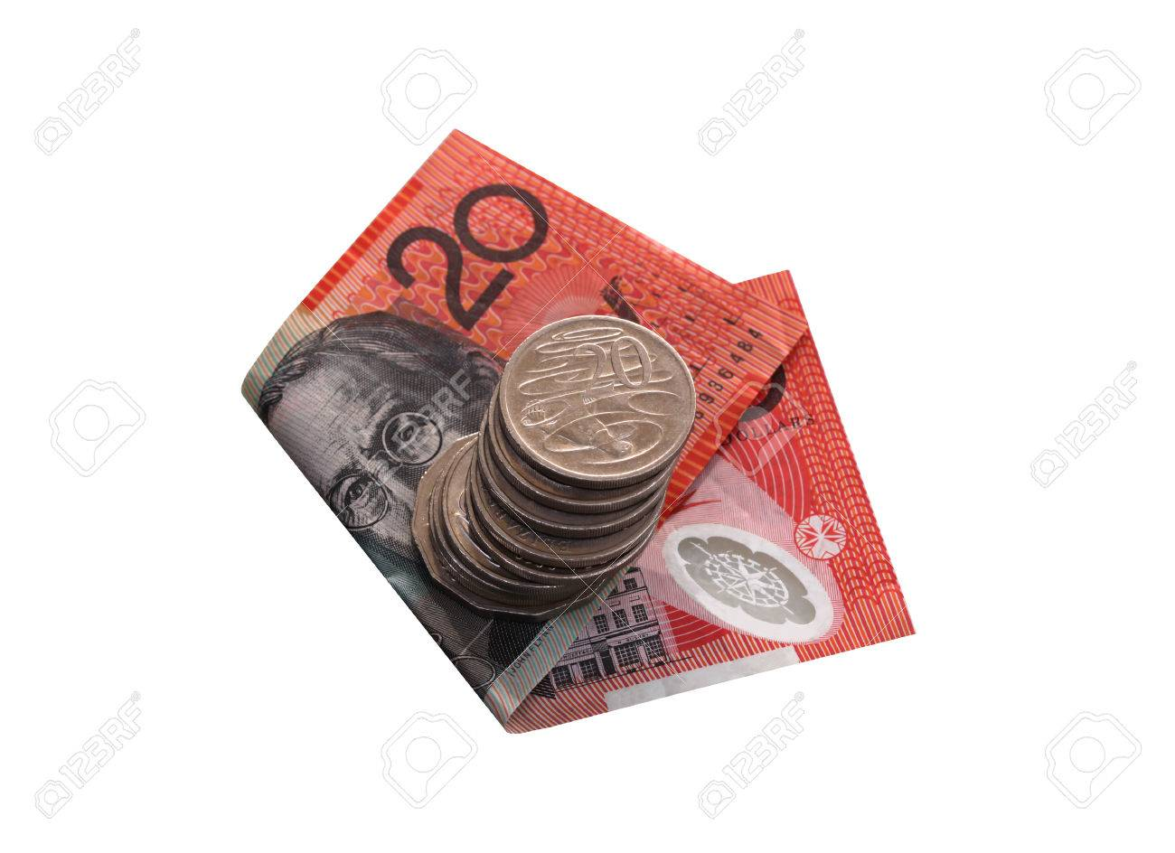 Australian twenty dollar note with a pile of silver coins  Note focus on top twenty cent coin Stock Photo - 24261040