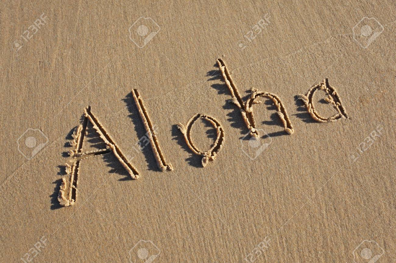 Aloha written in the sand at the beach aloha is a famous hawaiian aloha written in the sand at the beach aloha is a famous hawaiian greeting stock photo m4hsunfo