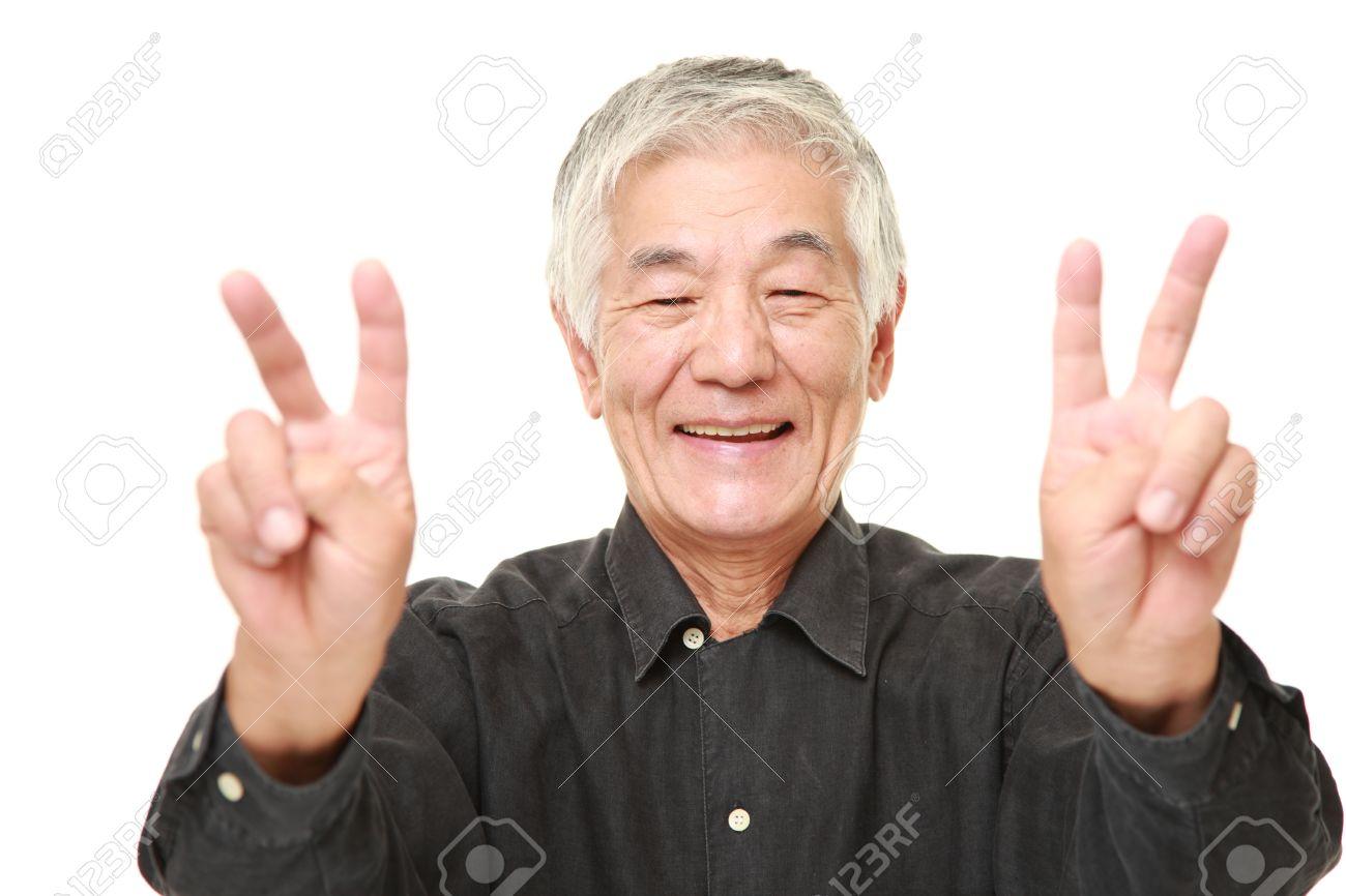 45669633-senior-Japanese-man-showing-a-v
