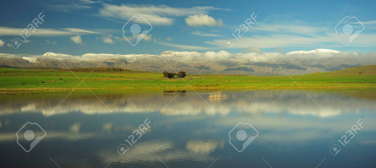 DAM REFLECTING SNOWY MOUNTAINS Stock Photo - 5466328