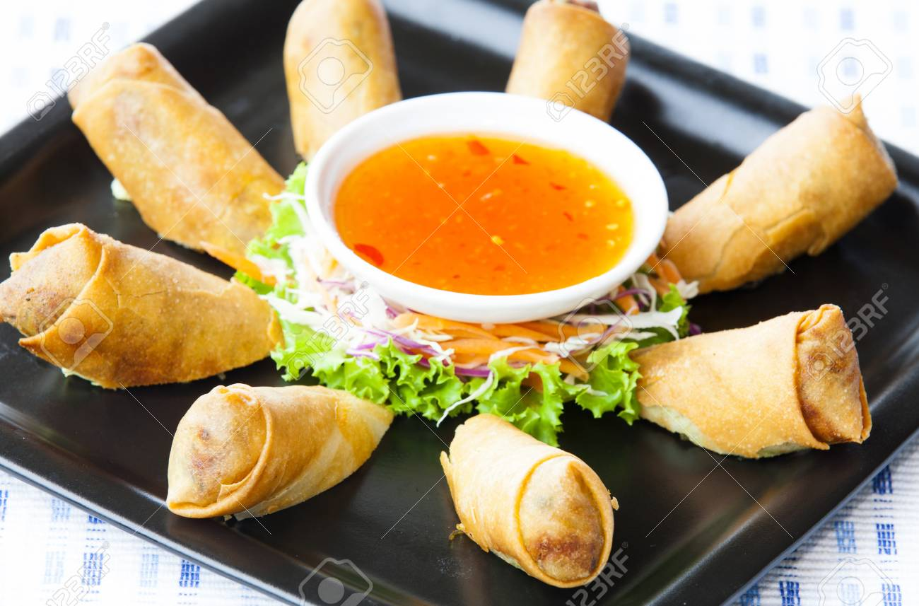 A Plate Of Spring Rolls With Sweet Chili Dip Sauce Stock Photo Picture And Royalty Free Image Image 53624787