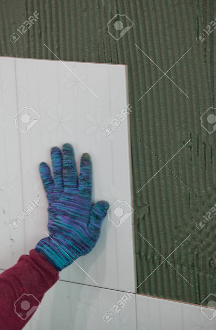 Man's hands placing a replacement ceramic tile Stock Photo - 24713350
