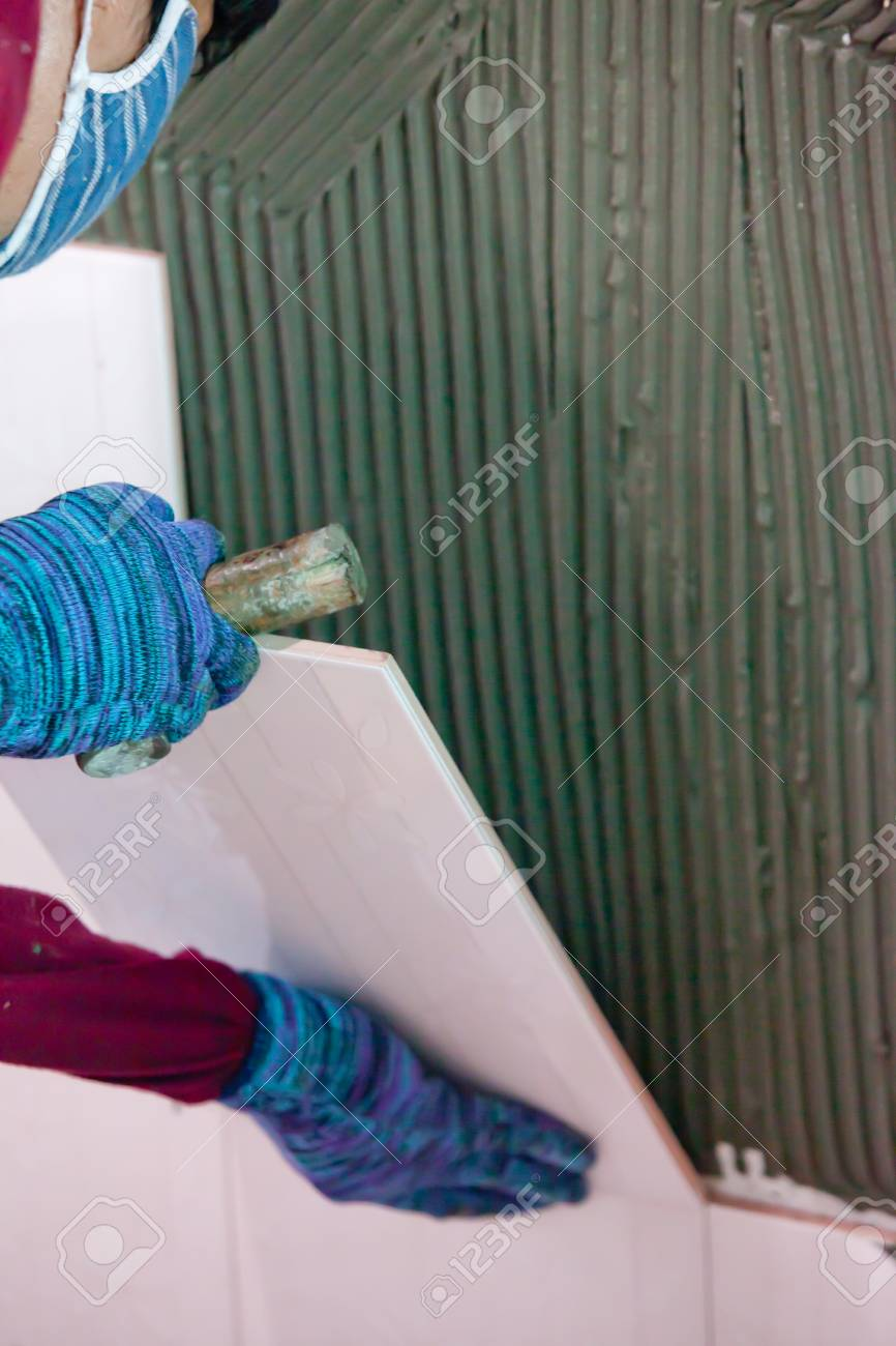 Man's hands placing a replacement ceramic tile Stock Photo - 24713353