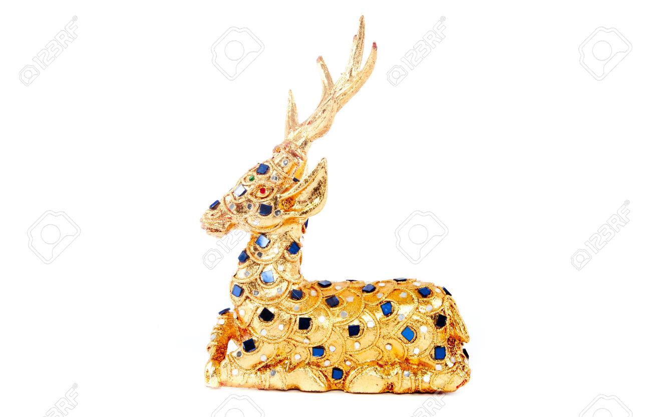 Gold reindeer on isolated white background using as decorate Stock Photo - 28995775