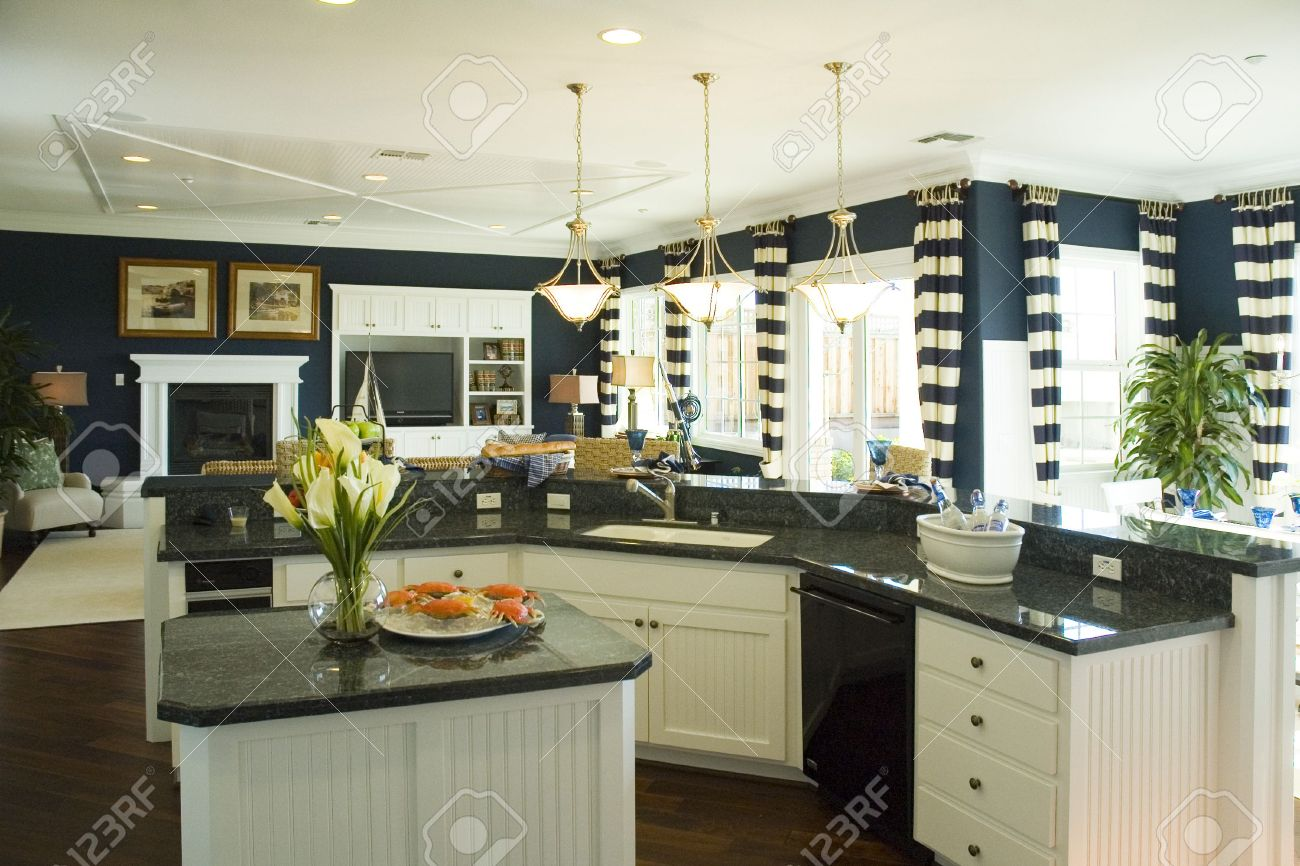 Modern Kitchen With Two Islands Adjoining Family Room And Dining Area In A California Home Stock