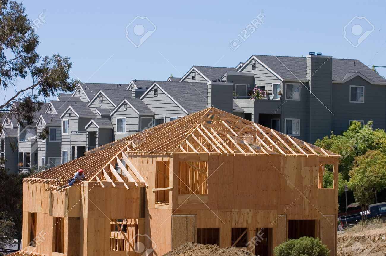 A Large Modern Wood Framed House Under Construction With