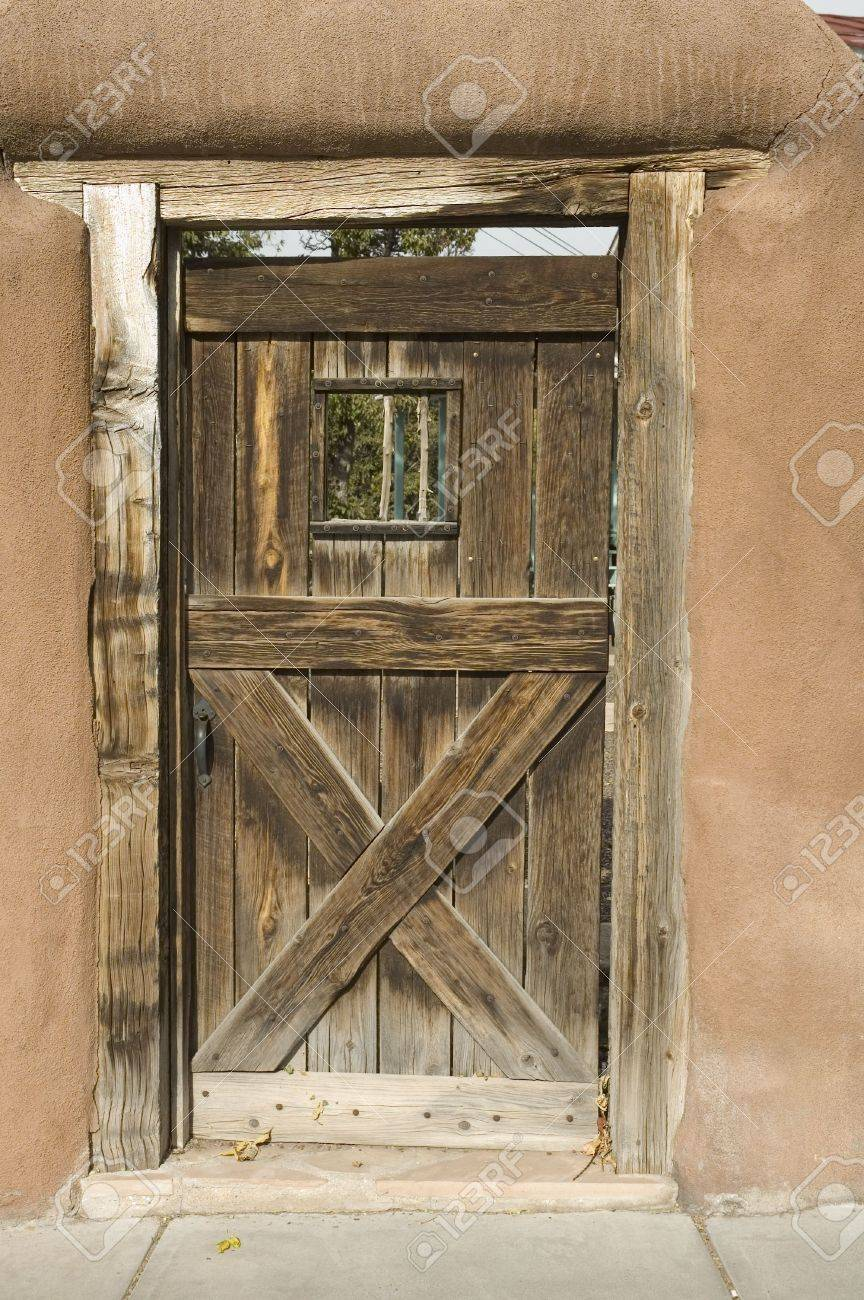 Rustic Gate Or Door Through An Adobe Wall Into The Gardenat A Home In Santa Fe
