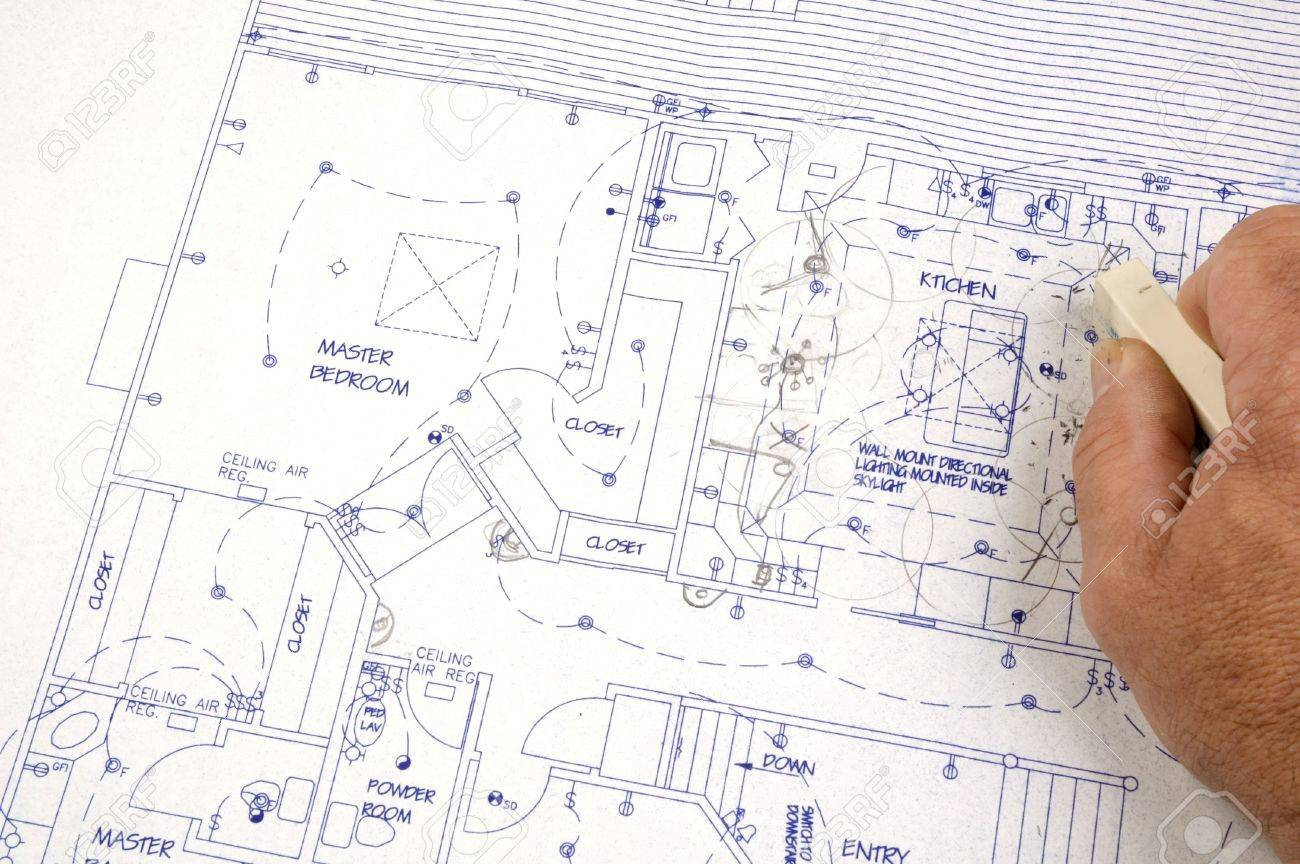 Erasing Changes Made To A Set Of Building Plans For A Custom House Stock Photo