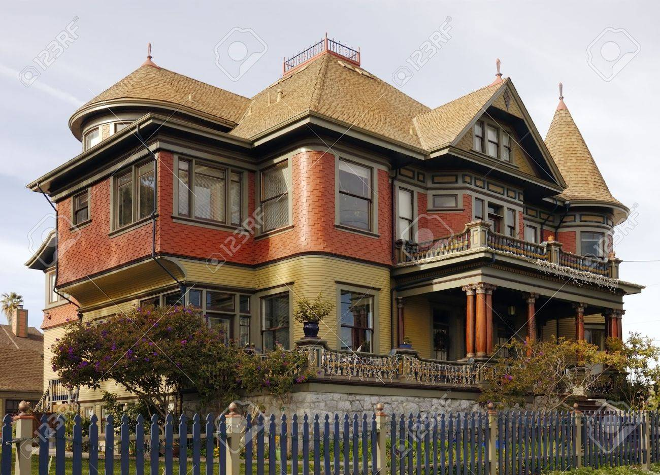 a large victorian home with a lot of filigree and gingerbread on the facade stock photo - Victorian Home
