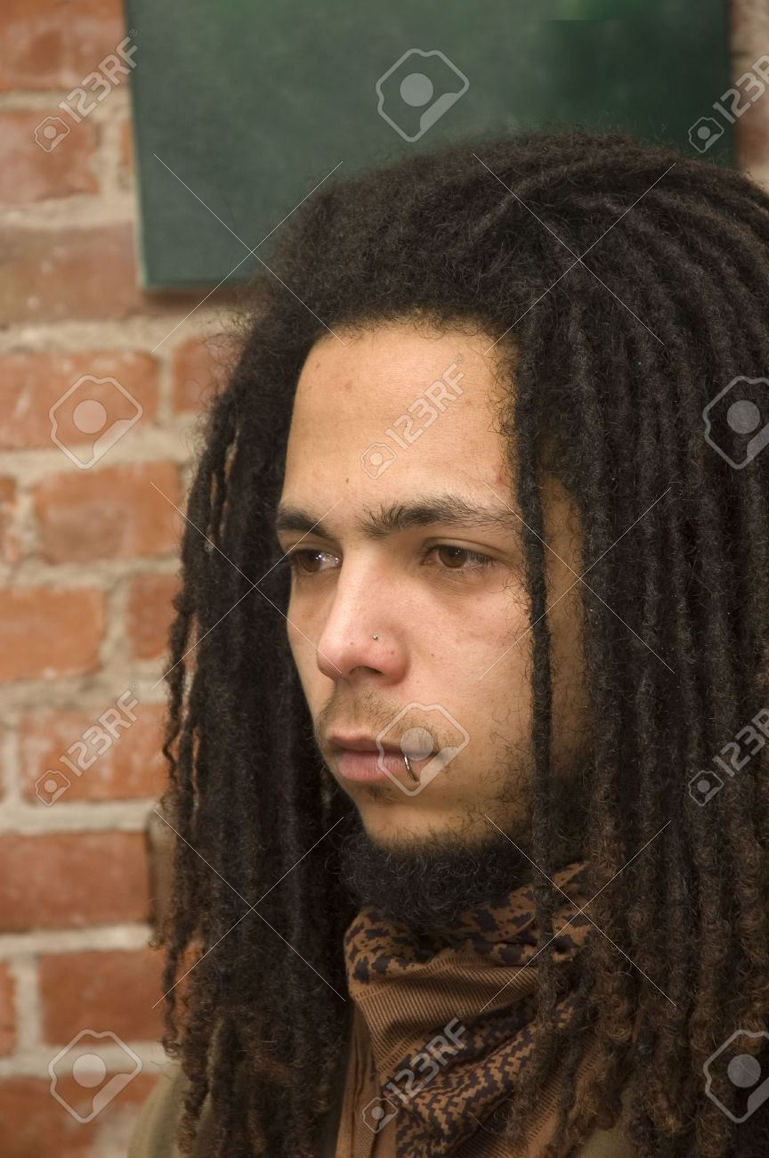 Young African American Man With Dreadlocks Lip And Nose Piercing