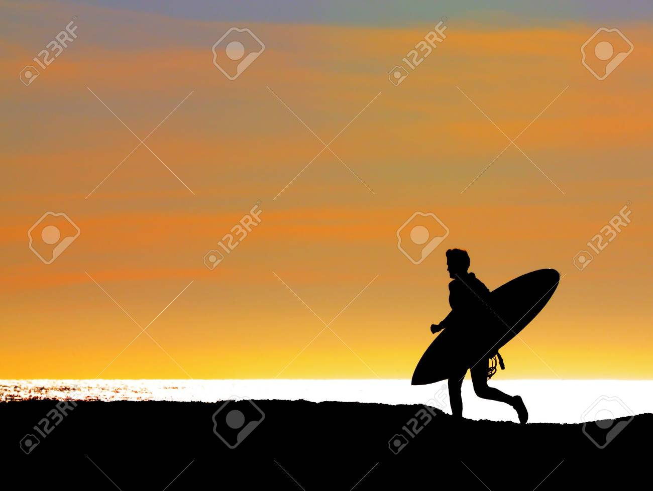 Surfer running out to sea to get the last wave in before sunset Stock Photo - 3305075