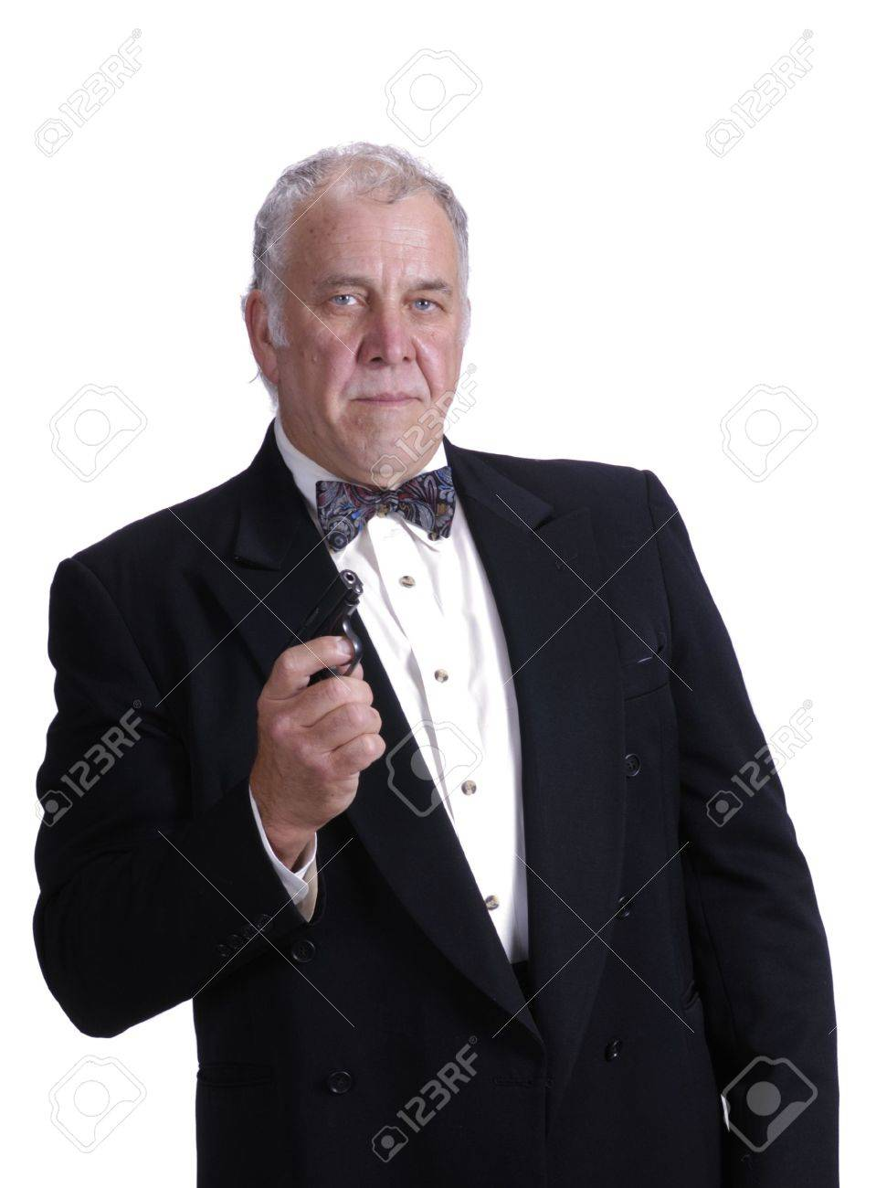 Older Businessman In A Suit Impersonating James Bond Isolated