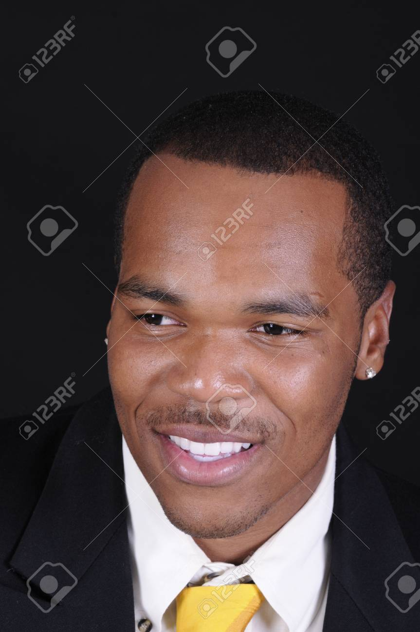 young African American man in a suit over a black background Stock Photo - 3527947