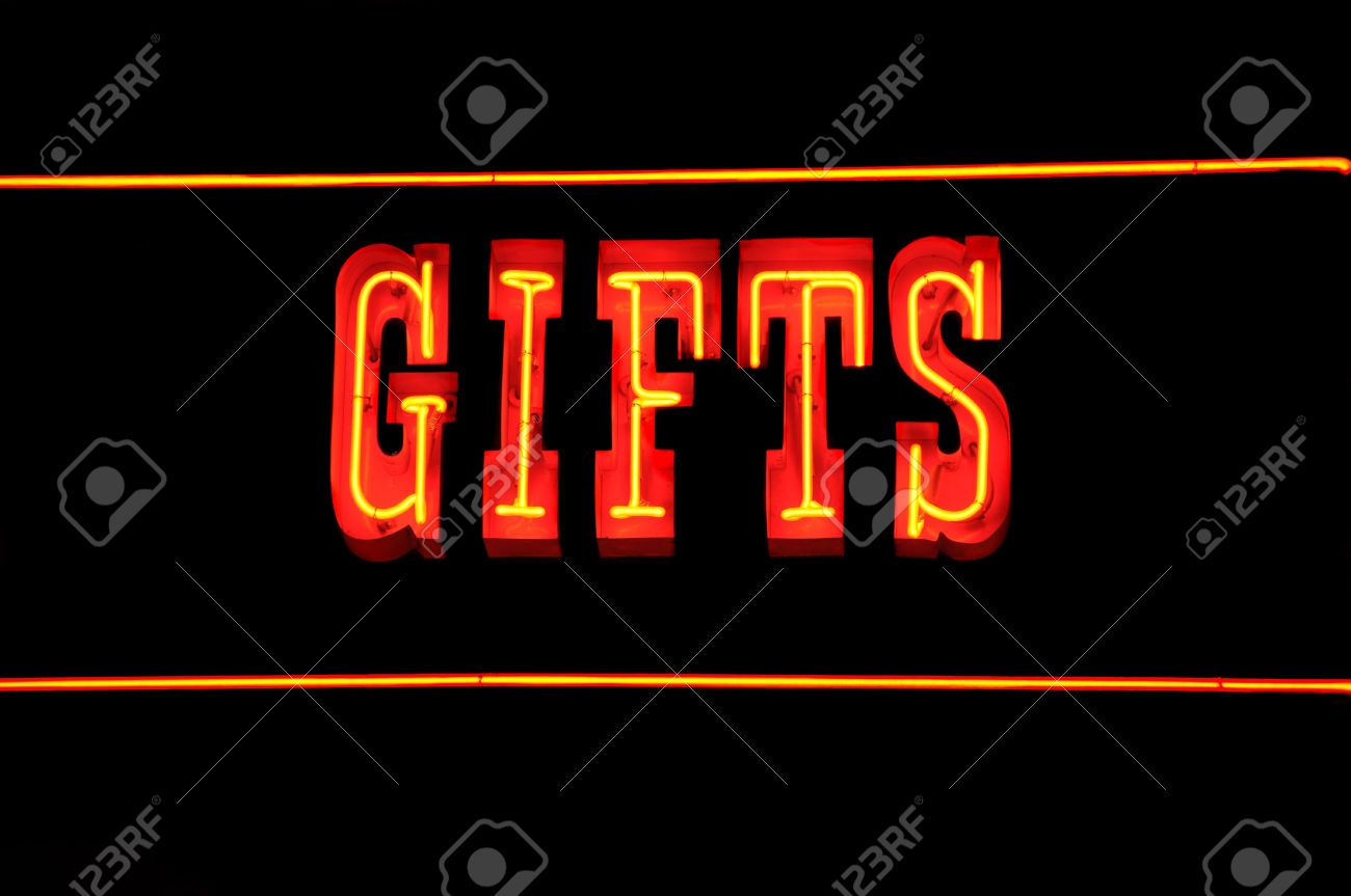 neon sign with the word gifts over black stock photo picture and