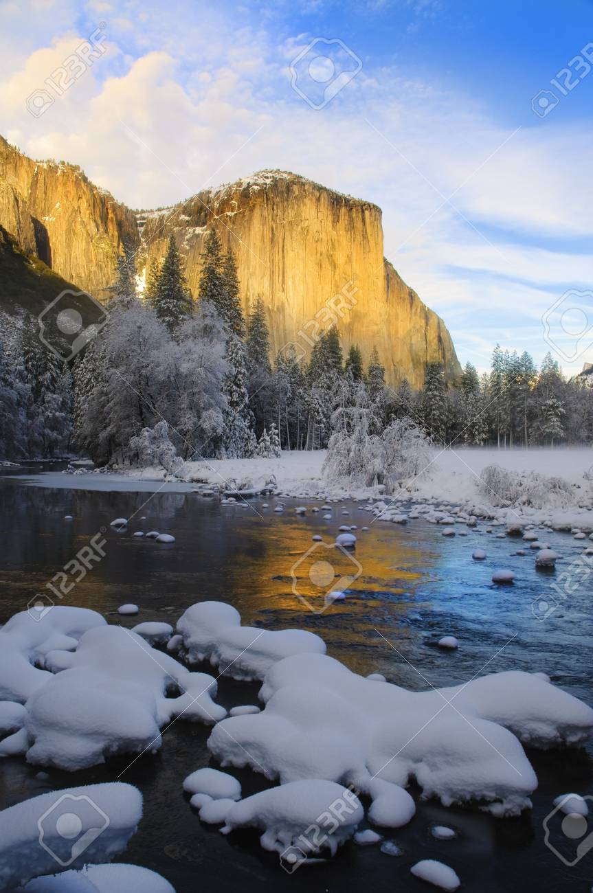 View of beautiful Yosemite valley in winter with the Merced river and snow covered El Capitan at sunset Stock Photo - 7401105