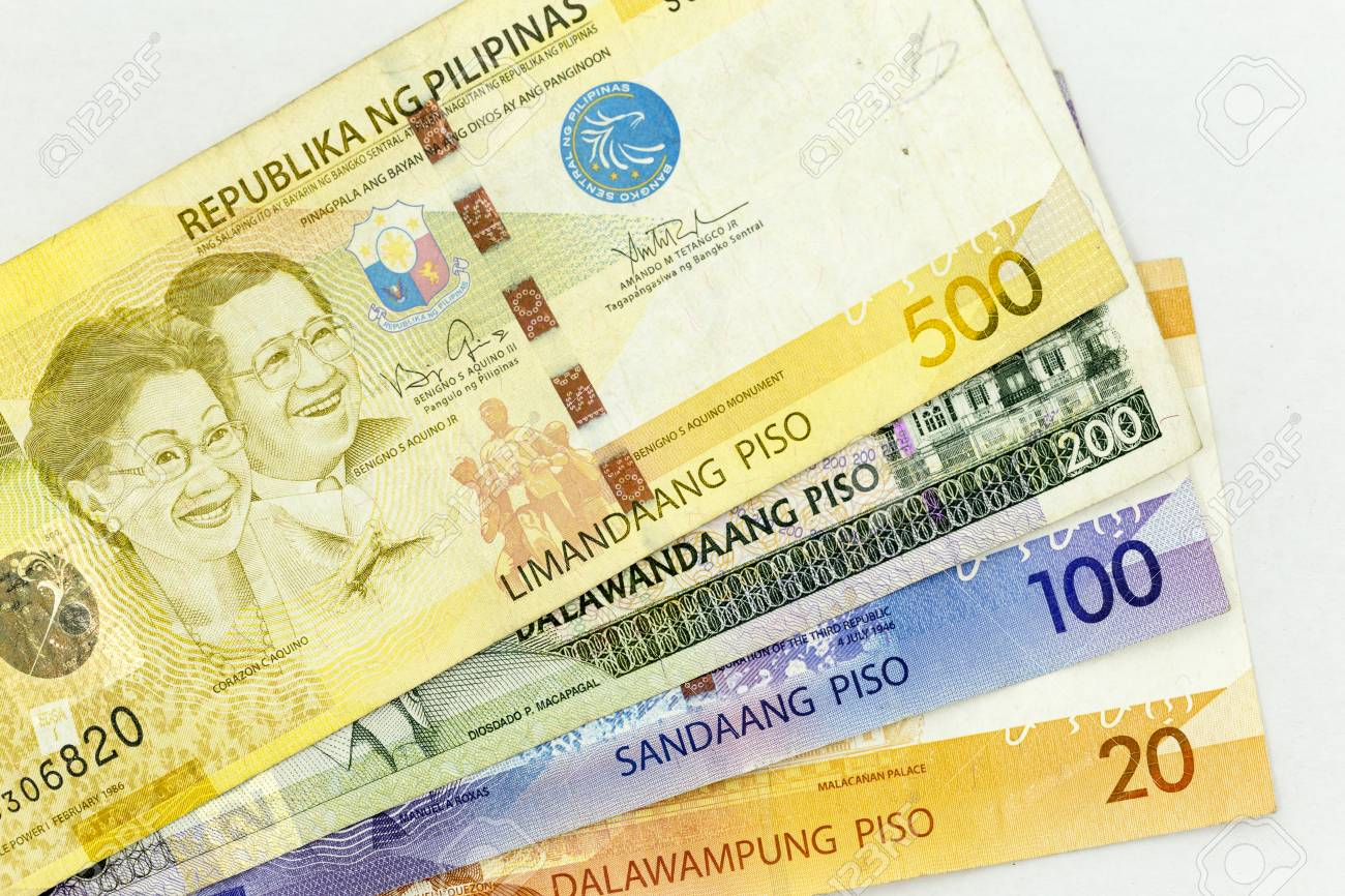 Currency banknotes spread across frame philippines peso in various
