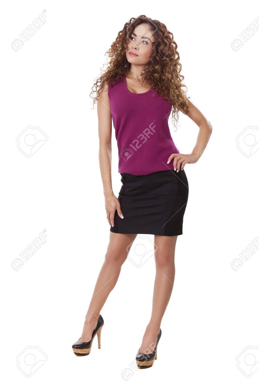 7cadf8b9f12 Stock Photo - Woman in little black skirt and heels
