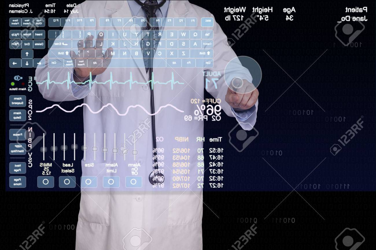 A medical professional using a virtual computer to enter a patients information Stock Photo - 23283603