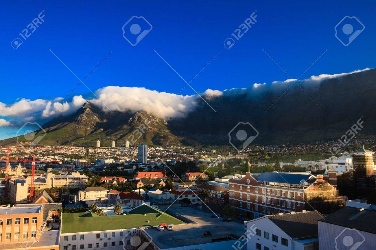 By a beautiful summer, a big cloud has formed on the Table Mountain in Cape Town, South Africa. Stock Photo - 12987226