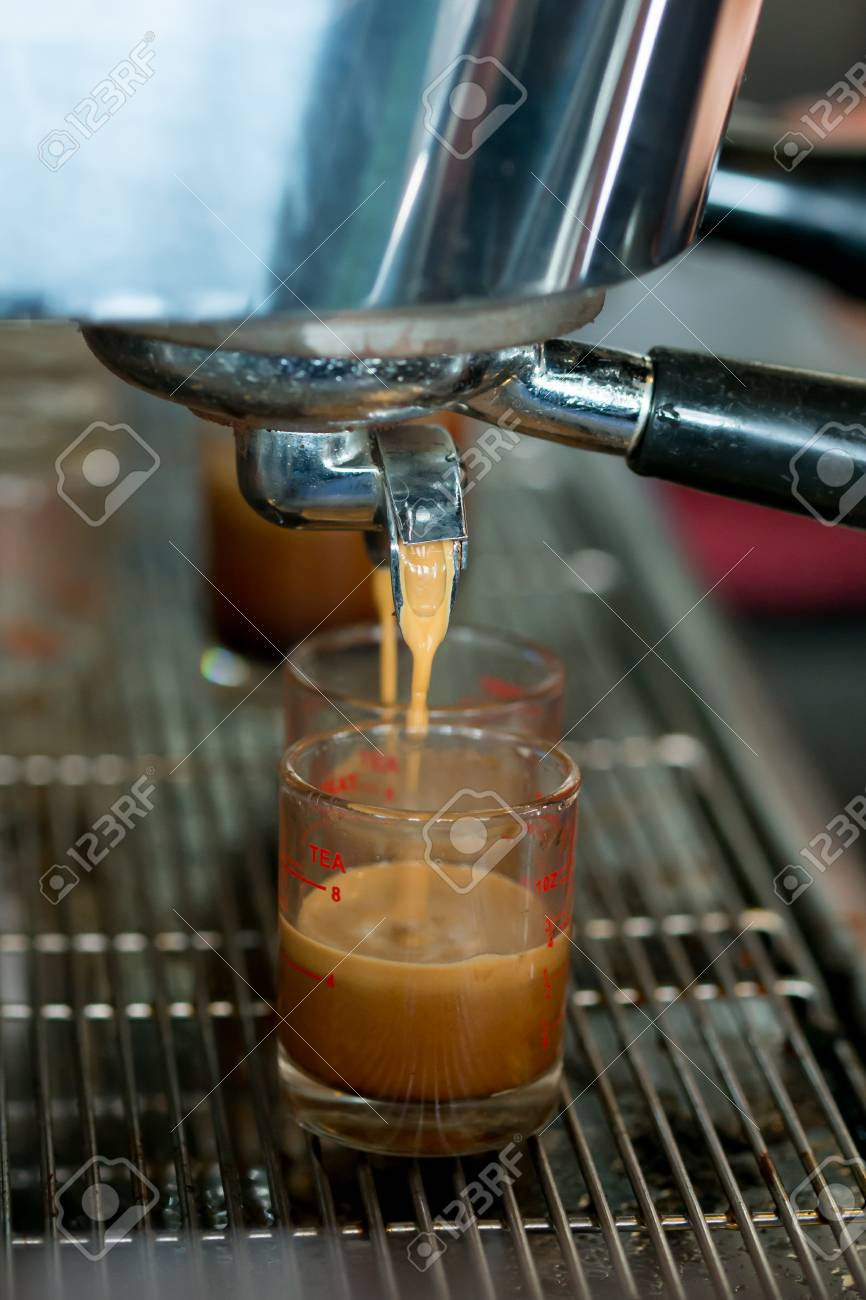 2 Espresso Shots Getting Brewed Into Shot Glasses Stock Photo