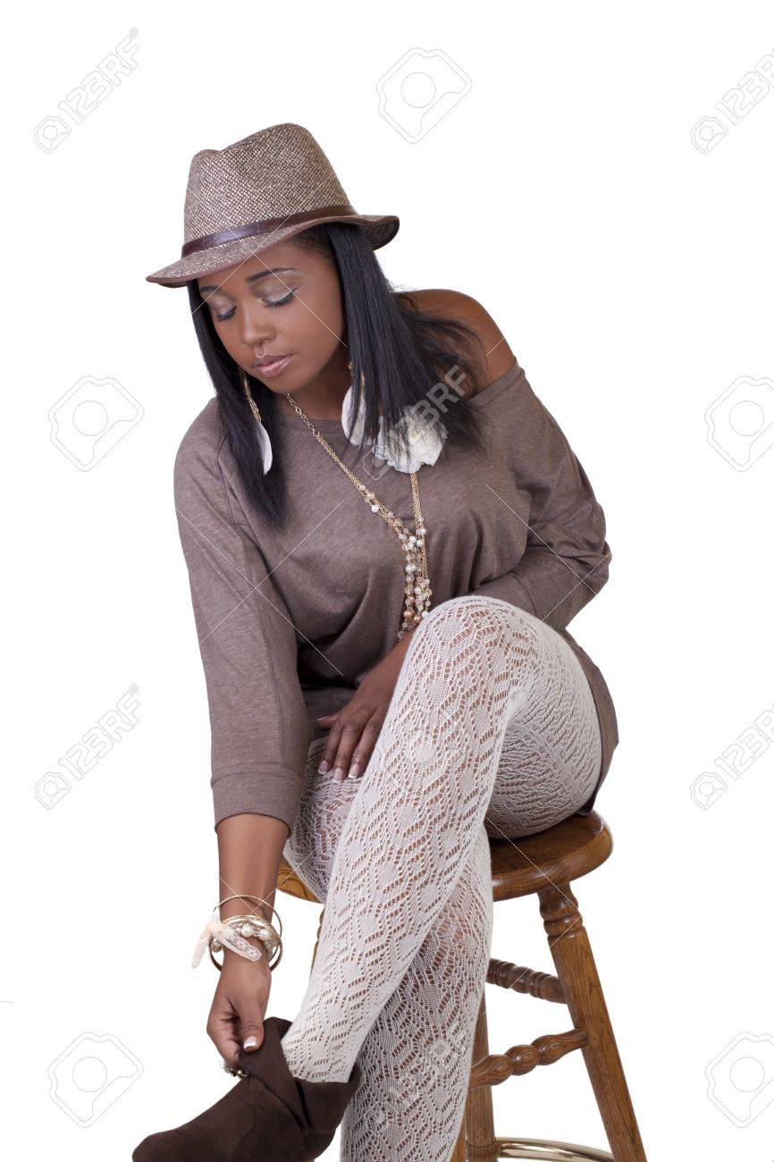 cf663774805 Young Black Woman in Hat and Textured Stockings Stock Photo - 12421155