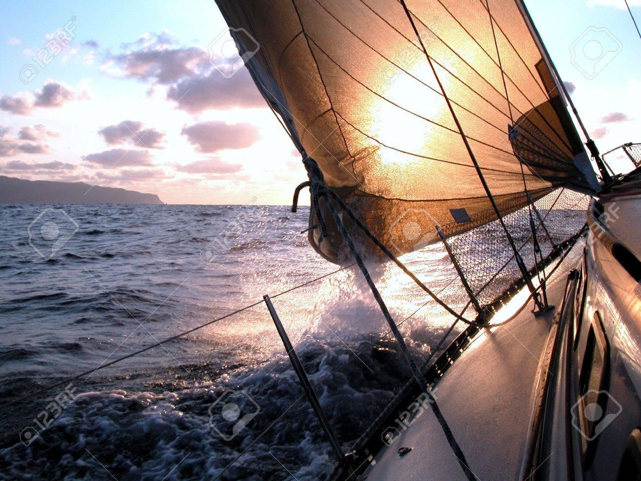 Sailing to the sunrise during a regatta in Atlantic Ocean Stock Photo - 511761