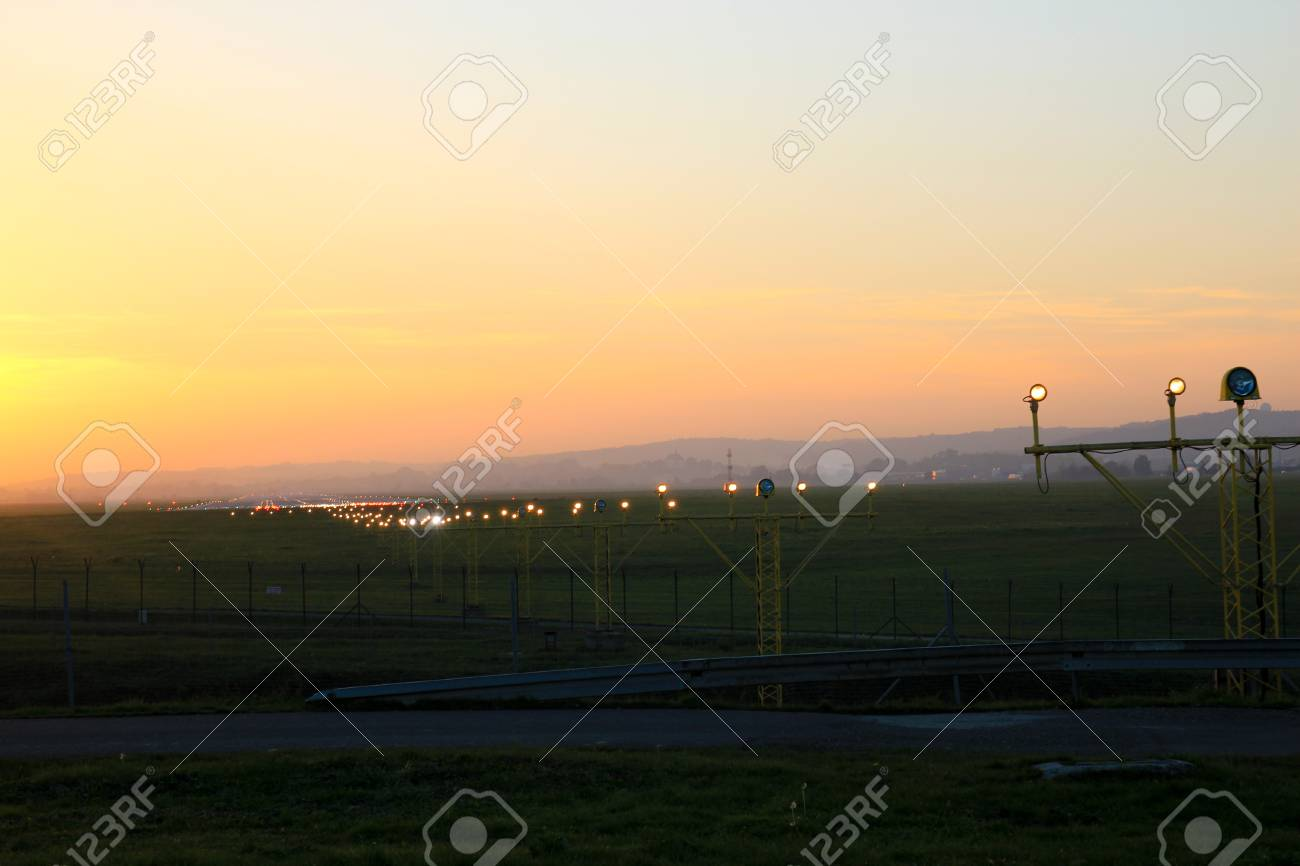 Flight security lights and landing strip in sunsed bakground stock flight security lights and landing strip in sunsed bakground stock photo 96648697 mozeypictures Image collections