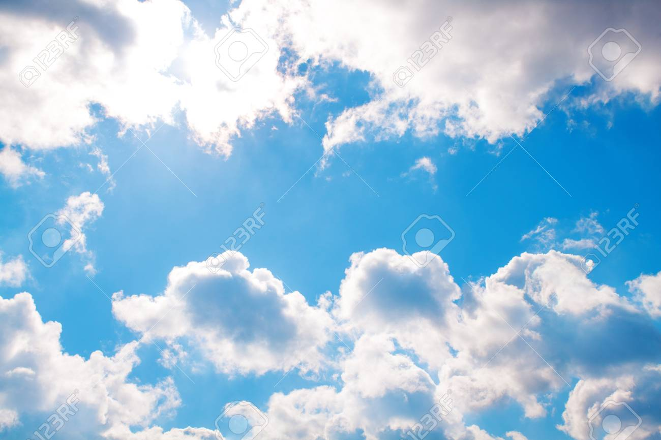 White fluffy clouds in the blue sky Stock Photo - 18678559