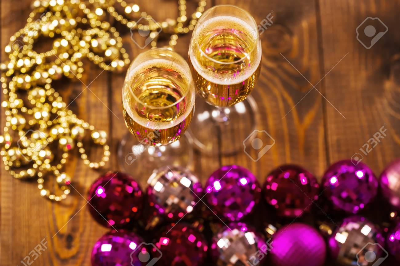 Two Glasses With Champagne And Christmas Tree Decorations On Stock Photo Picture And Royalty Free Image Image 46712258