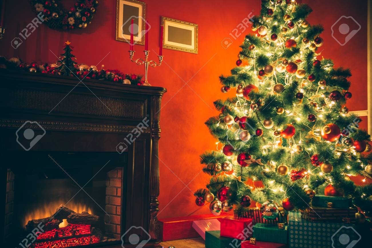beautiful christmas living room with decorated christmas tree gifts and fireplace the idea for