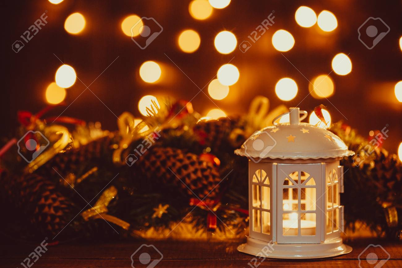 Christmas Lantern With Burning Candles And Garland On Vintage ...