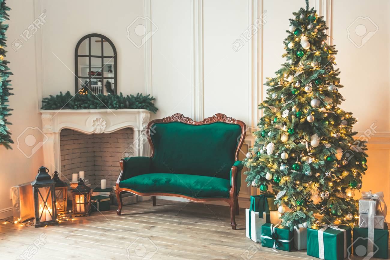 Christmas Living Room With A Fireplace Sofa Christmas Tree Stock Photo Picture And Royalty Free Image Image 90024833