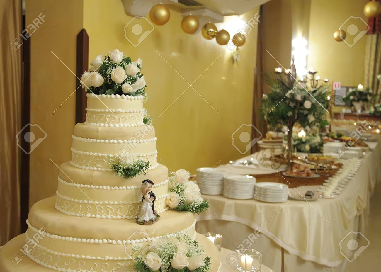 Wedding Cake With The Decoration Of The Bride And Groom And Table ...