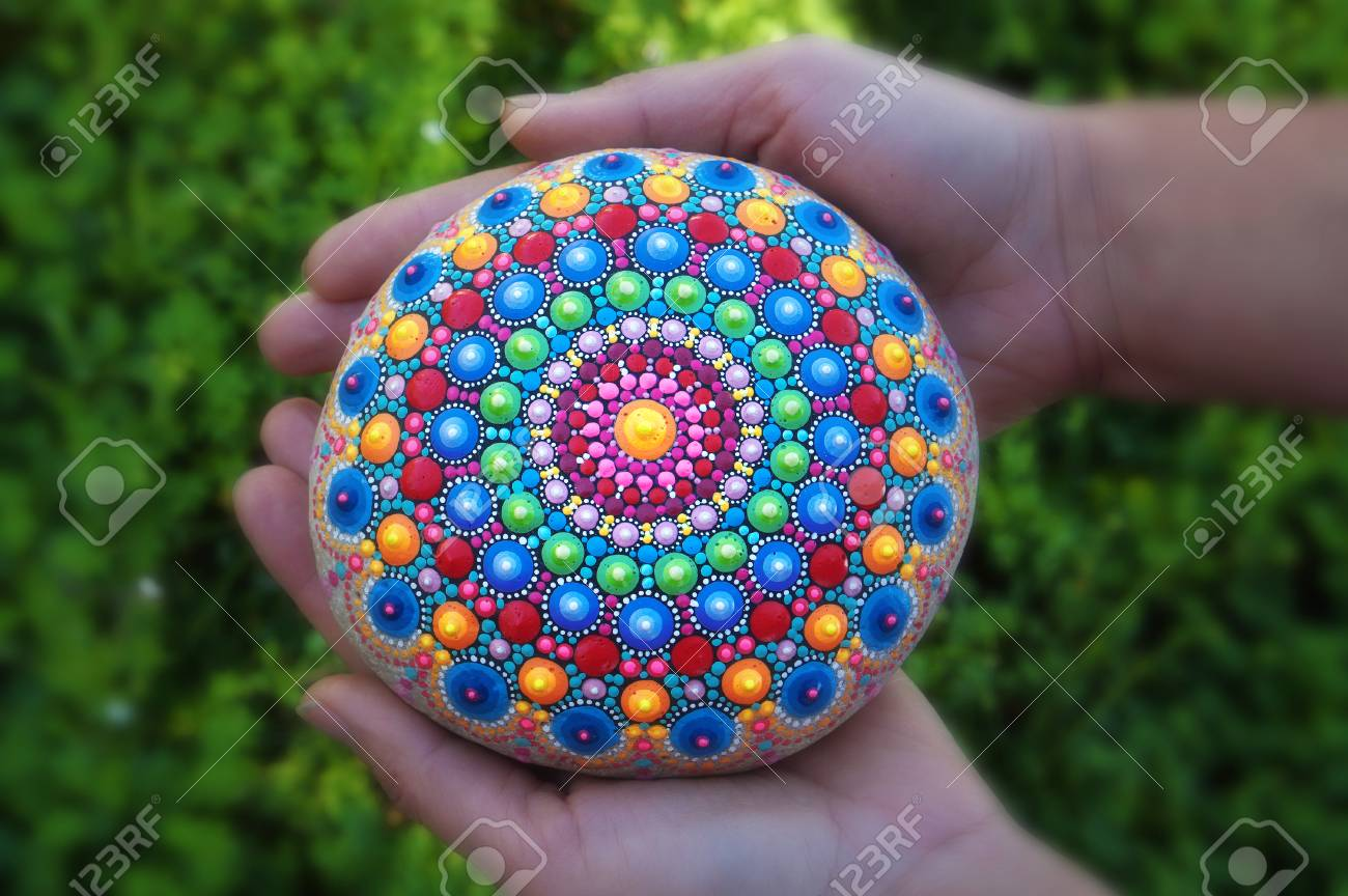 Mandala Dot Painting Colorful Stone Holding In Hands Stock Photo