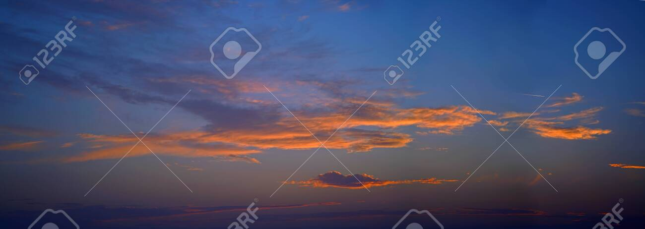 Beautiful sky with orange clouds at sunset with airliner - 123664627